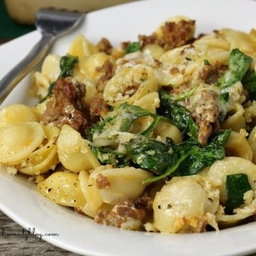 sausage orechiette casserole plated with fork