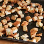 finished product baked croutons on sheet pan