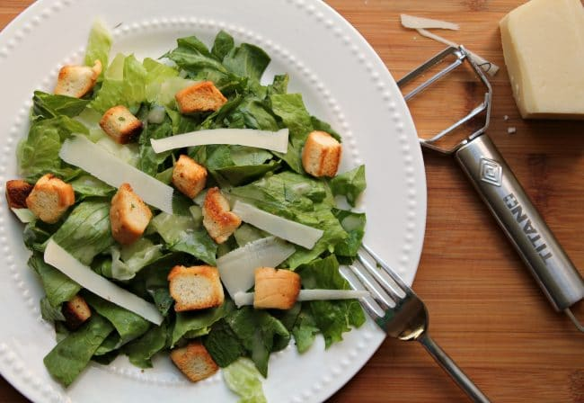 prepared caesar salad featuring homemade croutons