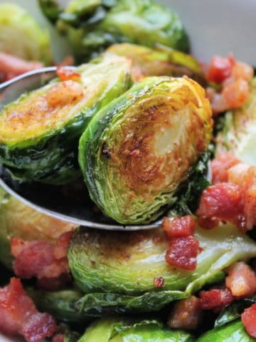 crispy brussels sprouts on spoon close up