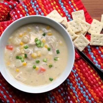 Creamy Chicken Vegetable Soup in a bowl with crackers