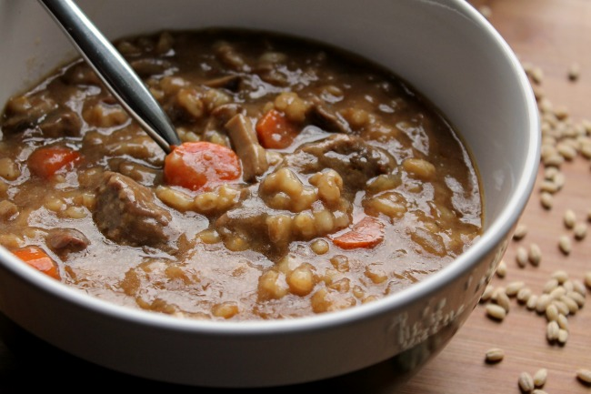 instant pot beef mushroom barley stew in bowl with spoon