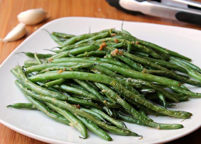 green bean recipe on white platter