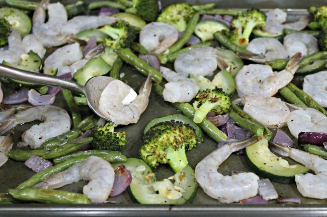sheet pan shrimp and veggies adding shrimp to pan