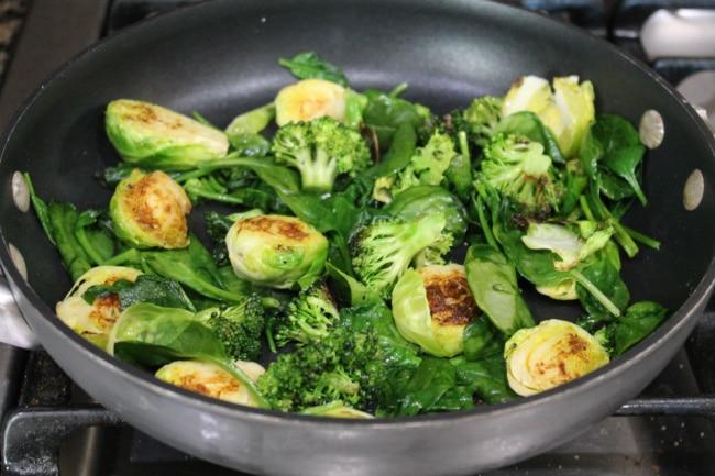 veggies cooking in pan