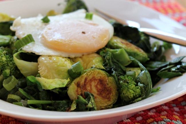 veggie breakfast bowl topped with egg