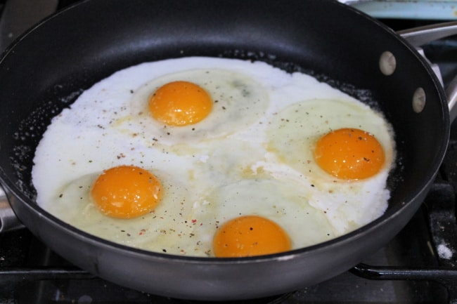 eggs cooking for breakfast fries
