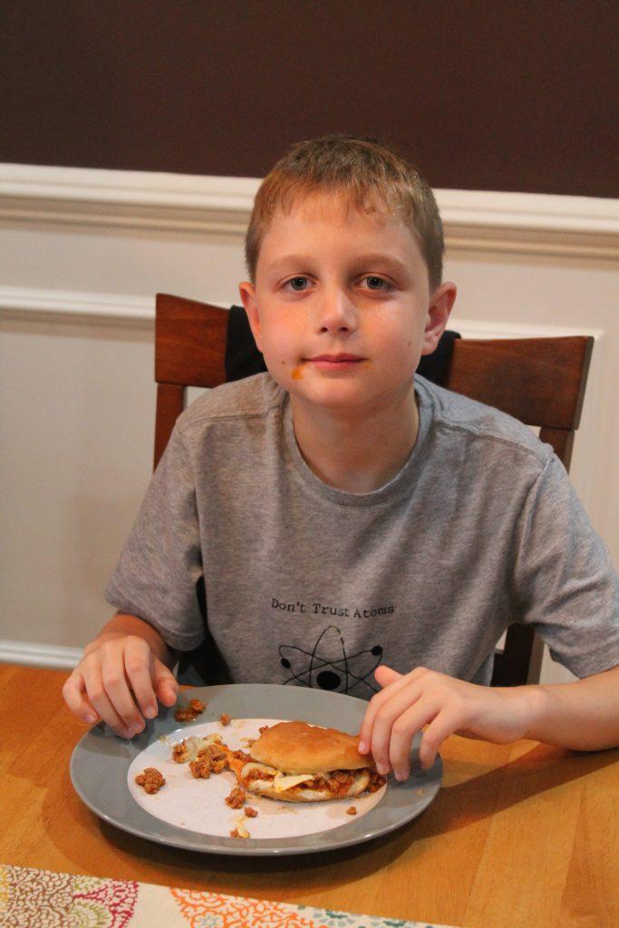 kid eating sloppy joes