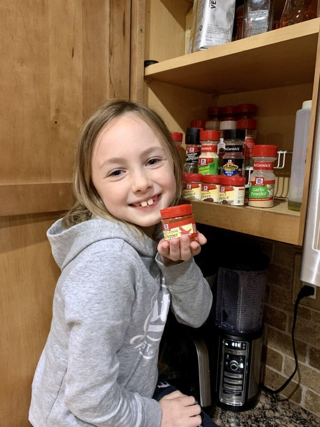 nora holding cayenne pepper