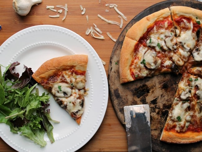 pizza cooked with slice on plate