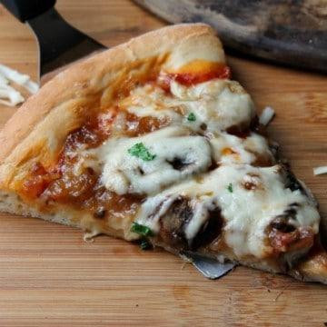 slice caramelized onion and mushroom pizza