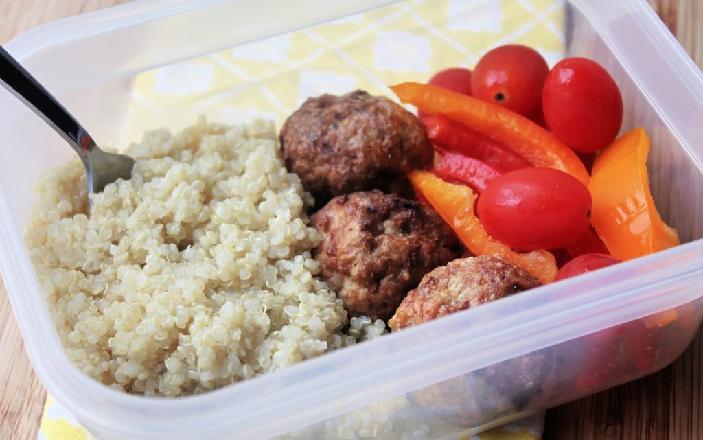 meal prep bowl with quinoa , turkey meatballs and sliced raw veggies