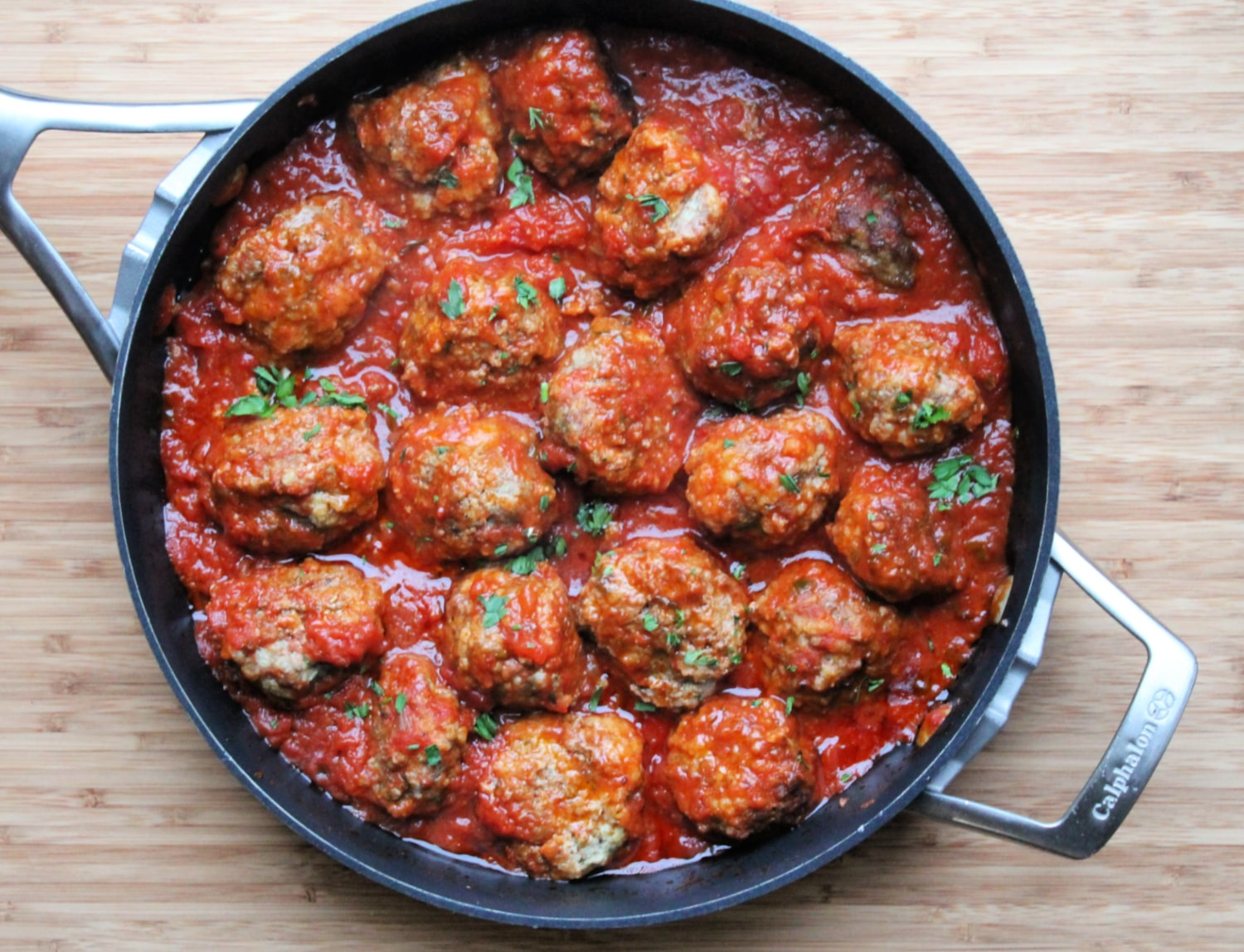 Turkey Meatballs in skillet with tomato sauce