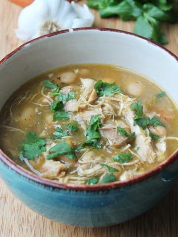 salsa verde chicken chili in bowl topped with cilantro