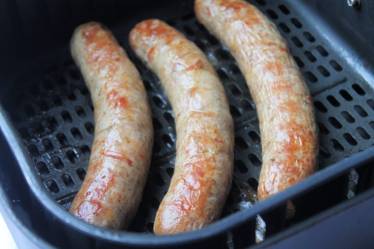 cooked sausage in air fryer basket