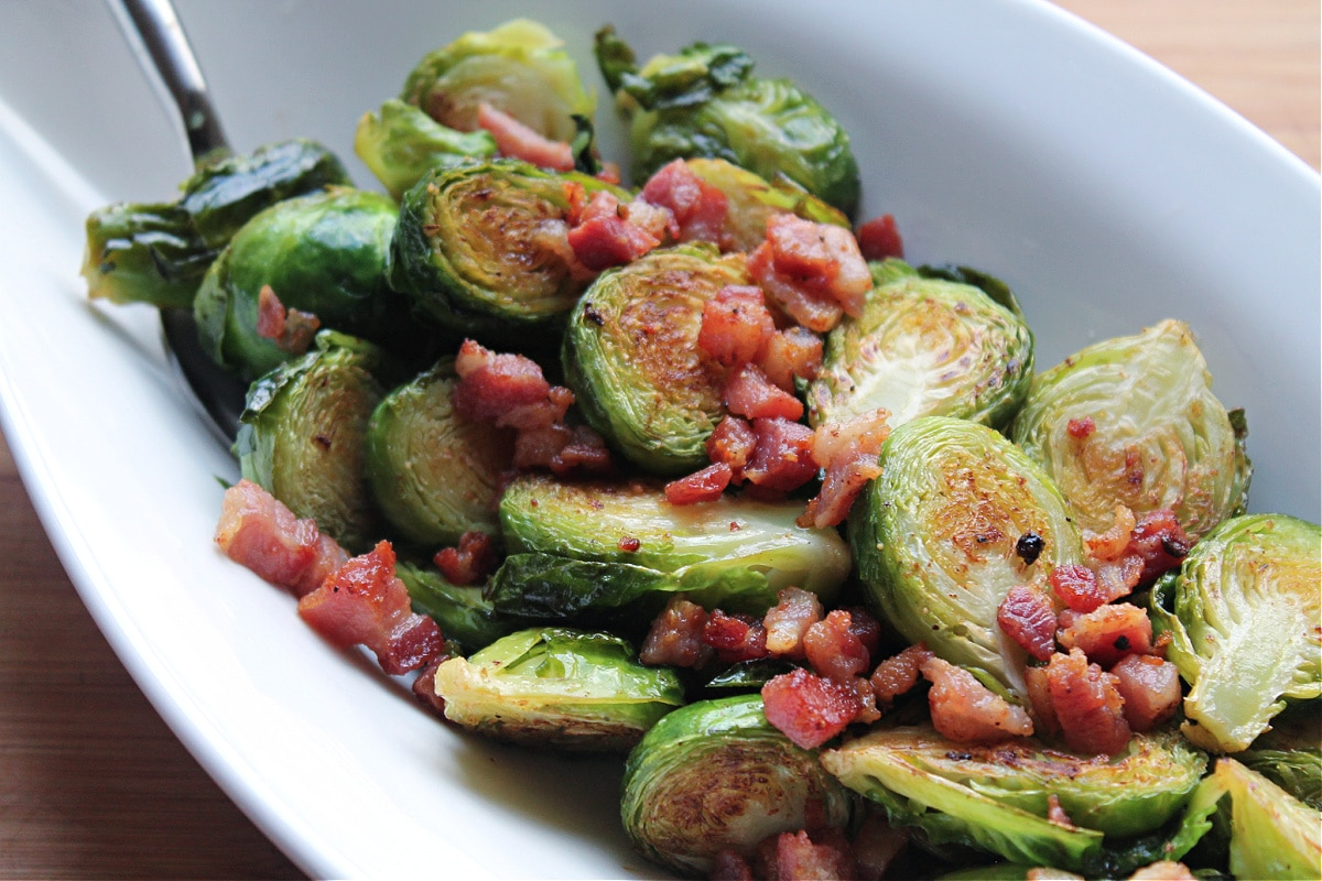 finished brussels sprouts in whie serving bowl
