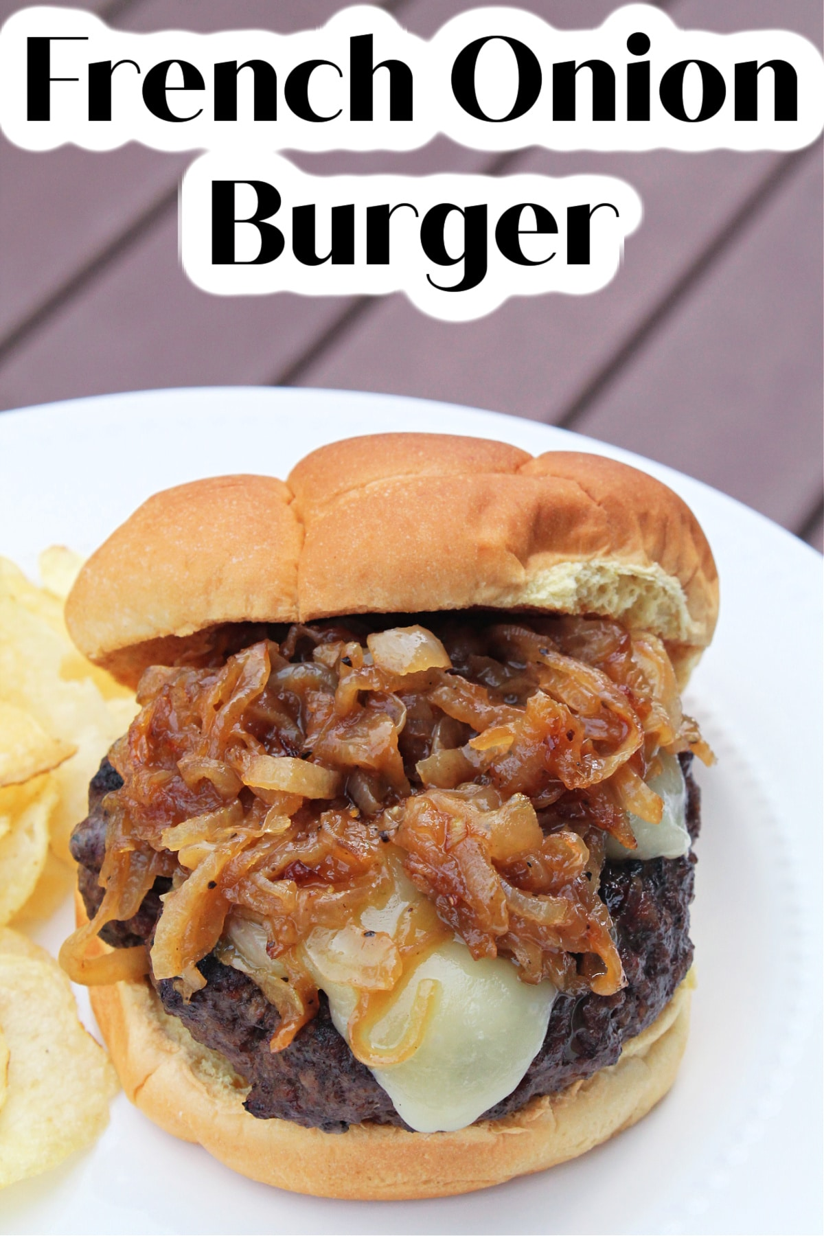 burger prepared with onions smothered on top with text reading french onion burger