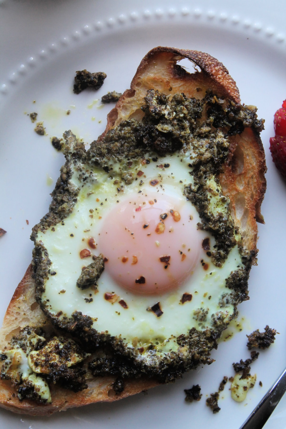 close up of cooked pesto egg on toast