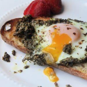 runny yolk of egg on toast
