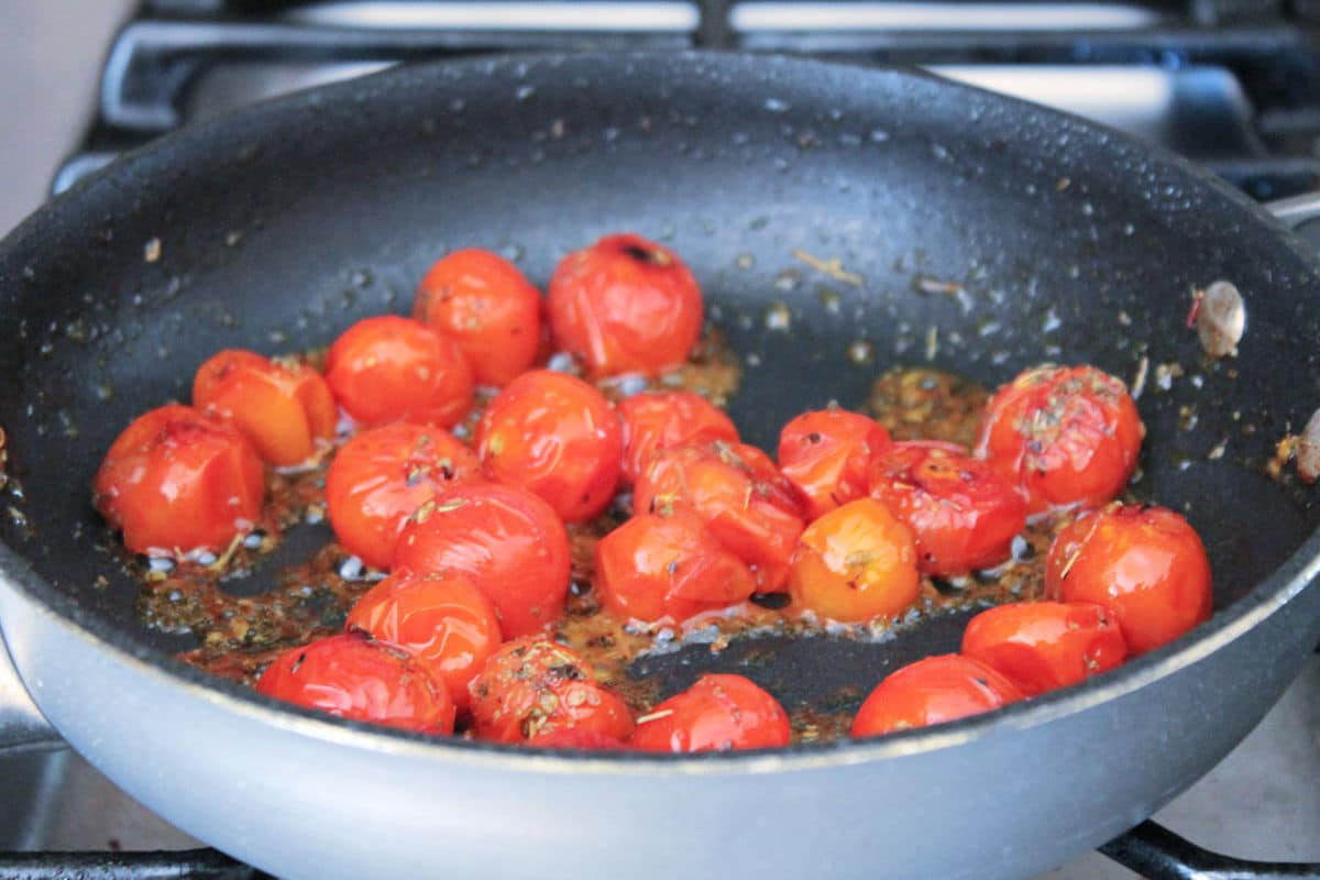 tomatoes, softened in pan with herbs