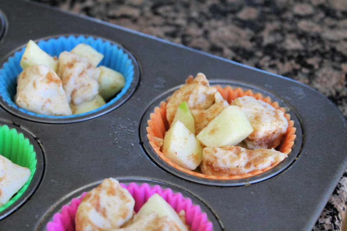 monkey bread ingredients mixed and in baking cups ready to bake