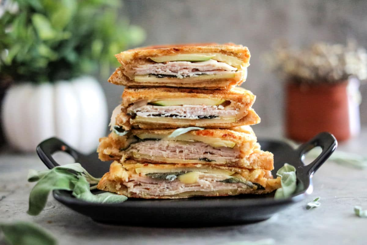 four halves of cooked panini stacked on a dish