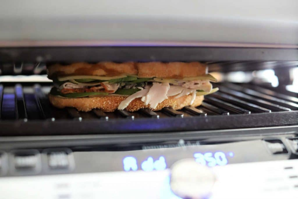 panini inside the press cooking