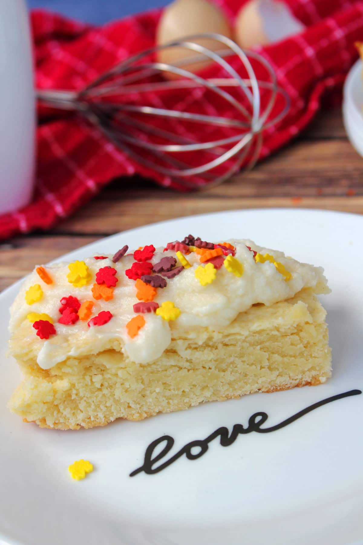 """sugar cookie bar on plate that says """"love"""" on it."""